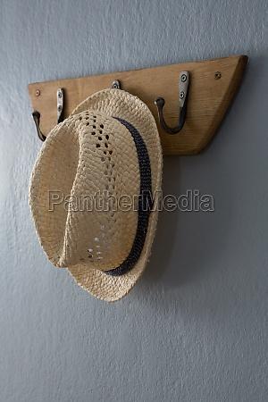 straw hat hanging on hook