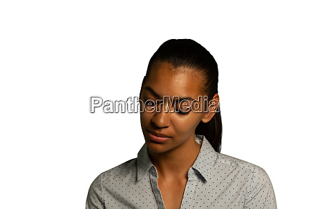young thoughtful businesswoman looking down