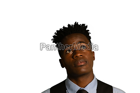 puzzled businessman looking up