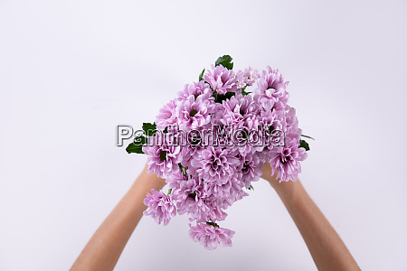 woman holding a pink bouquet of