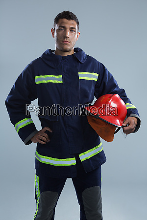 fireman standing with hand on hip