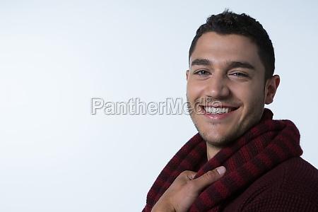 man in warm clothing smiling at