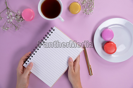 woman holding a notebook during the