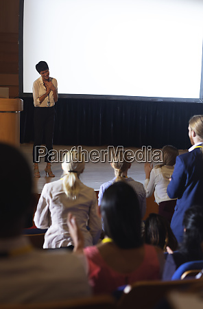 businesswoman thanking the audience while finished