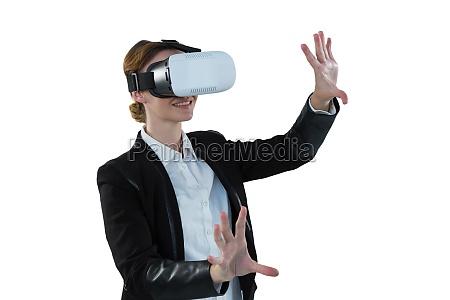 businesswoman using virtual reality headset