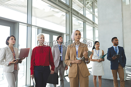 business people looking away while standing