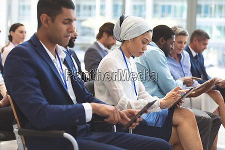 business people using digital tablet during