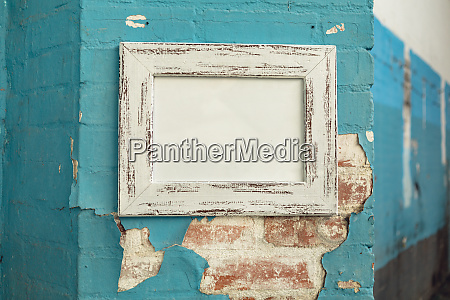 blank picture hanging on a wall