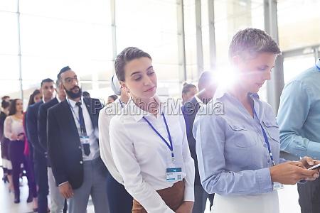 business people standing in queue in