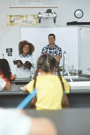 african ethnicity schoolboy next to his