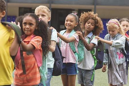 school kids standind in a queue