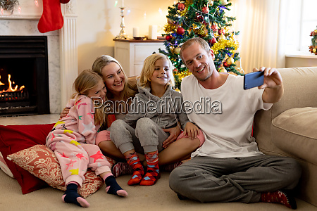 family at home at christmas time