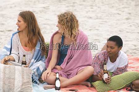 group of friends enjoying on beach
