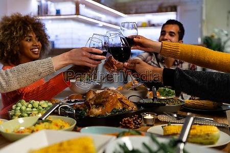 millennial adult friends celebrating thanksgiving together