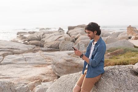caucasian man using mobile phone at