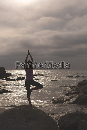 caucasian woman perform yoga on the