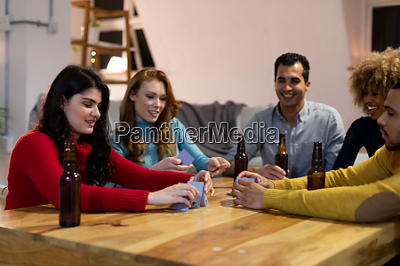 millennial adult friends socialising together at