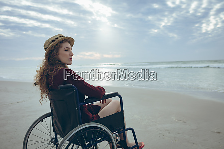 woman disable sitting on wheelchair at