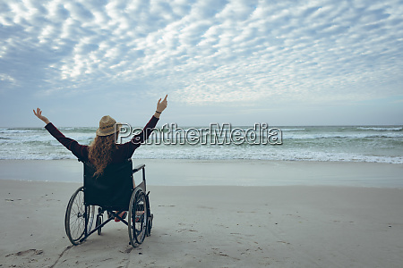 woman disable sitting with open arm