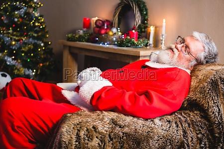 santa claus taking a nap on