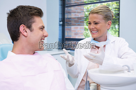 happy patient discussing with dentist