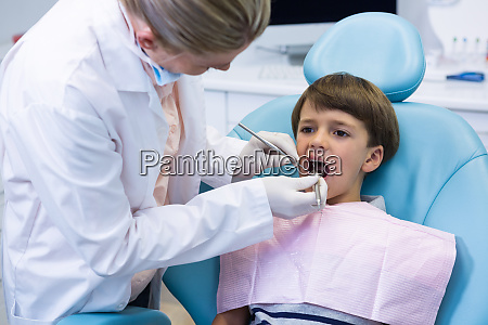 boy receiving dental treatment by dentist