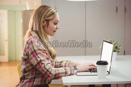 female executive working on laptop in