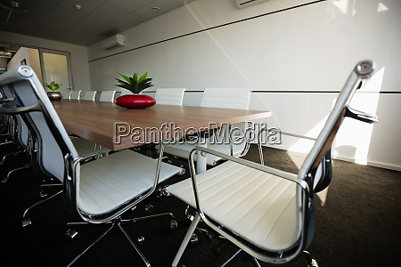 empty chairs by conference table at