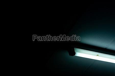 opened led light tube on dark