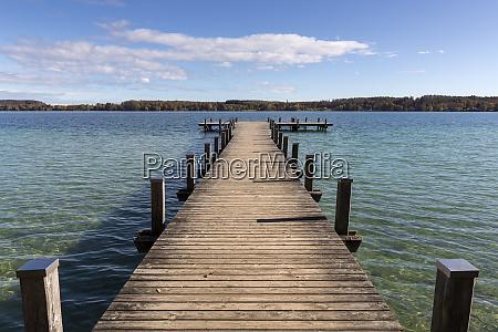 jetty at lake woerthsee in bavaria