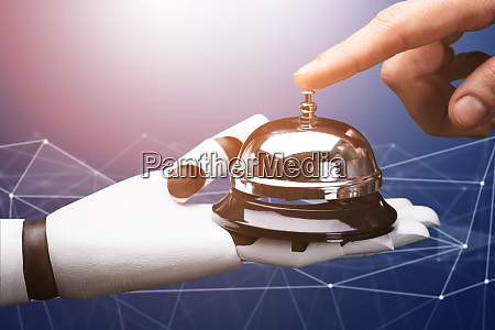 person ringing service bell hold by