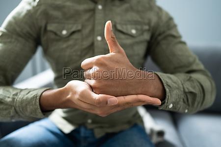 man using sign language to communicate
