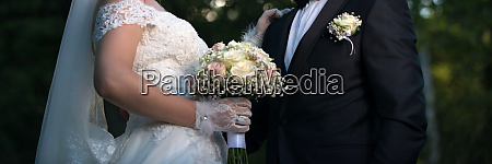 unrecognizable bride and groom pictured outdoor