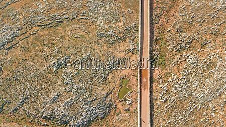 aerial view of road crossing arid