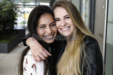 female students hugging in campus