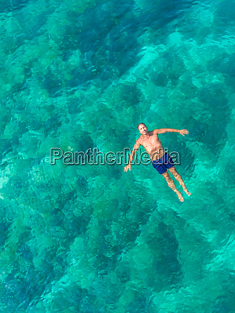 aerial view of man floating in