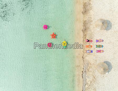 aerial view of people lying in