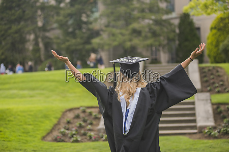 graduating student rejoicing at campus