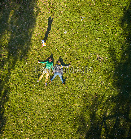 aerial view of family laying down