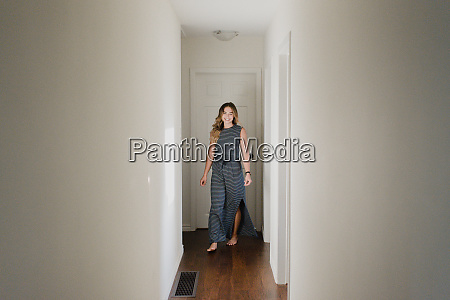 woman in hallway of home