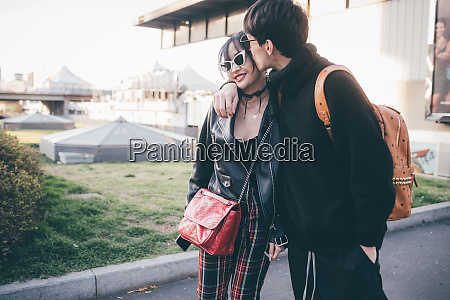 trendy young couple milan italy