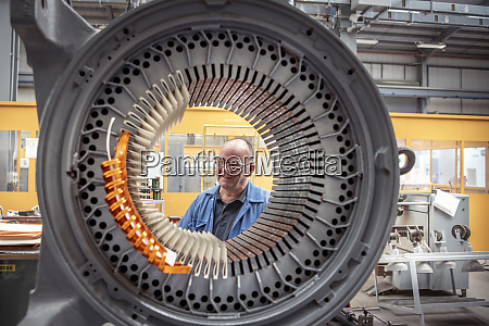 portrait of electrical engineer with generator