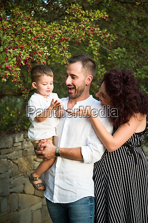 parents with son in park