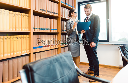 lawyers in library of law firm