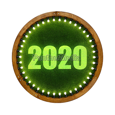 2020 sign over round green grass