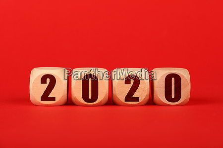 2020 wooden cube signs over red