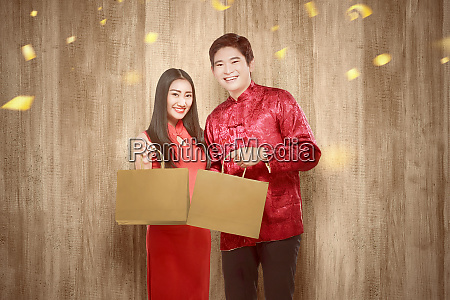 asian chinese couple in cheongsam dress