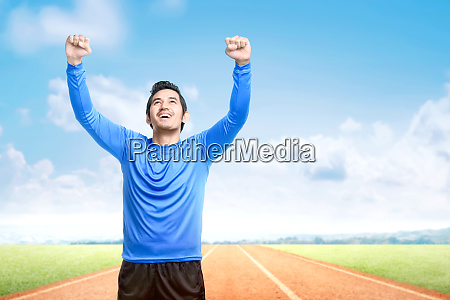 asian runner man with excited expression