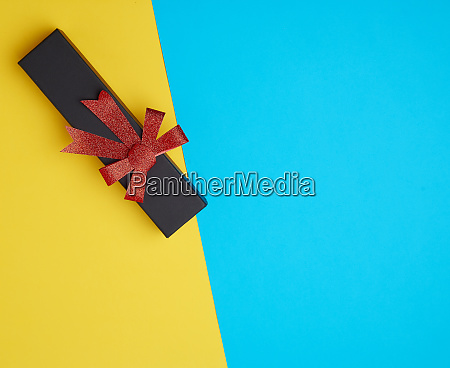 closed black paper cardboard box with