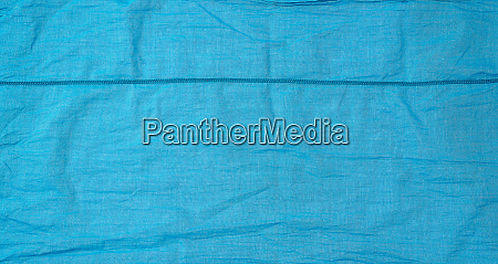 fragment of blue cotton fabric with